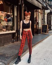 pants,high waisted pants,red pants,snake print,zip,black boots,platform lace up boots,black top,crop tops,black bag
