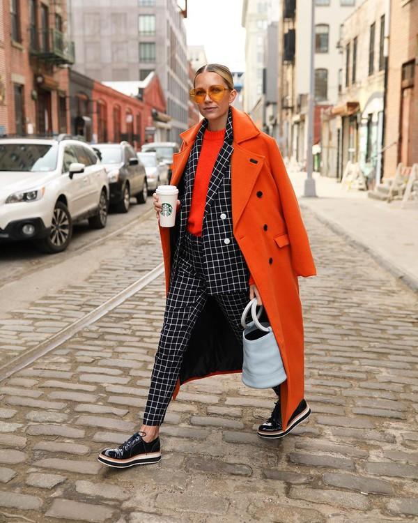 jacket plaid blazer double breasted black and white atlantic pacific black shoes patent shoes shoulder bag long coat orange coat sweater straight pants