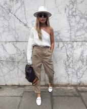 sweater,white sweater,off the shoulder,one shoulder,mules,high waisted pants,pleated,louis vuitton backpack,felt hat