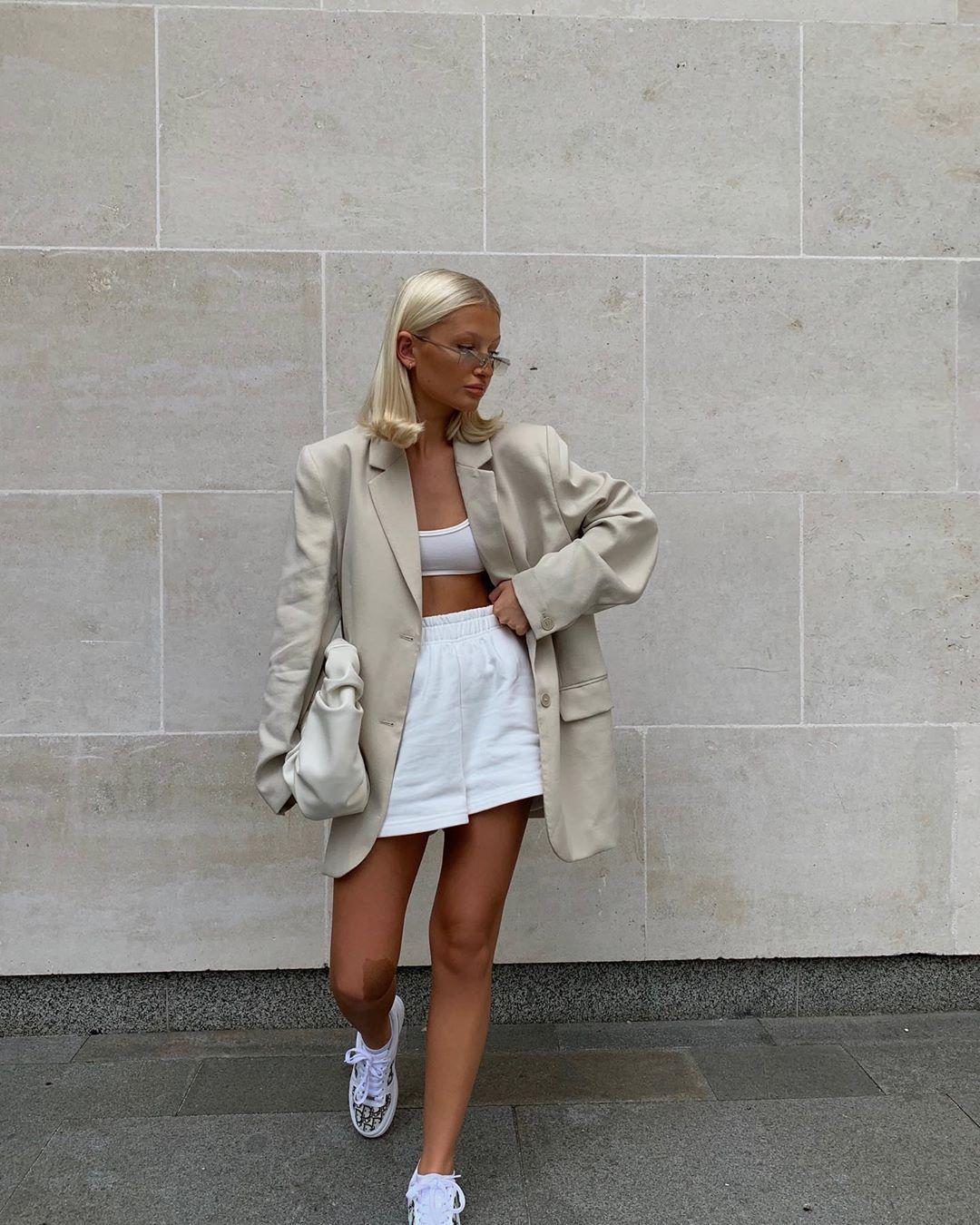 shorts white shorts oversized blazer sneakers sports bra bag
