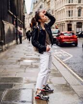 shoes,sneakers,high waisted jeans,cropped jeans,white jeans,straight jeans,black jacket,shoulder bag,top