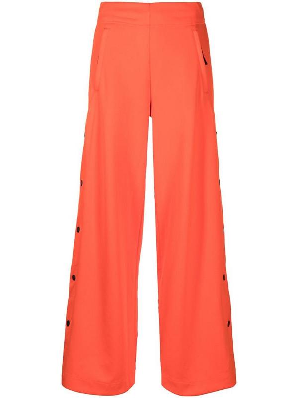 adidas high-rise wide-leg trousers in orange