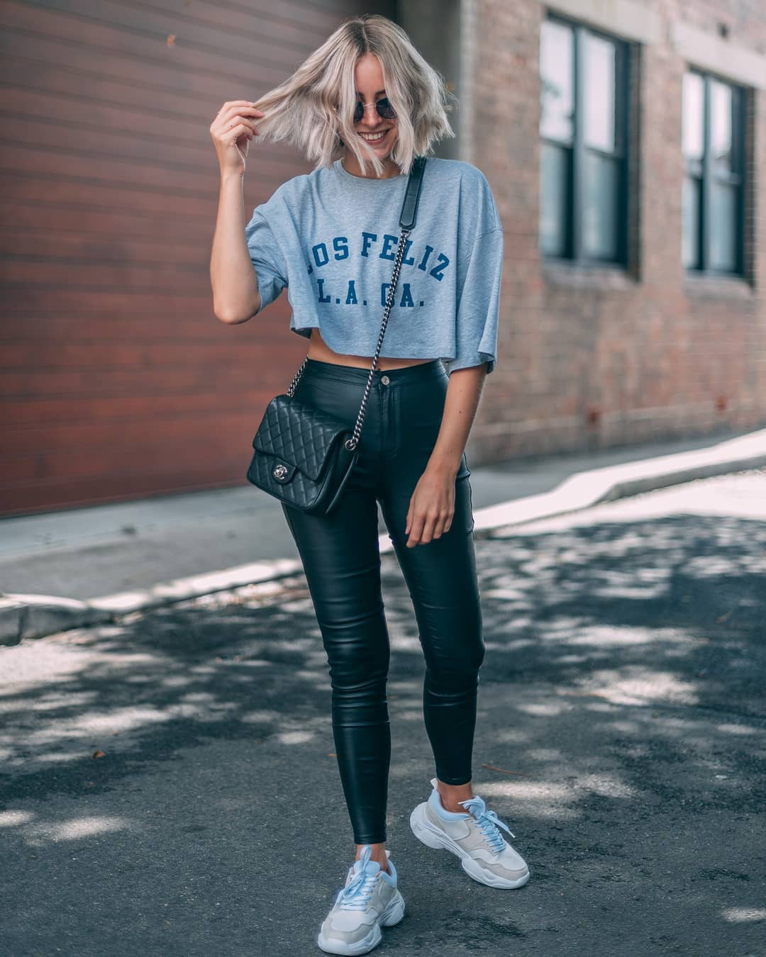 top cropped t-shirt grey t-shirt black leather pants high waisted pants skinny pants black bag chanel bag white sneakers