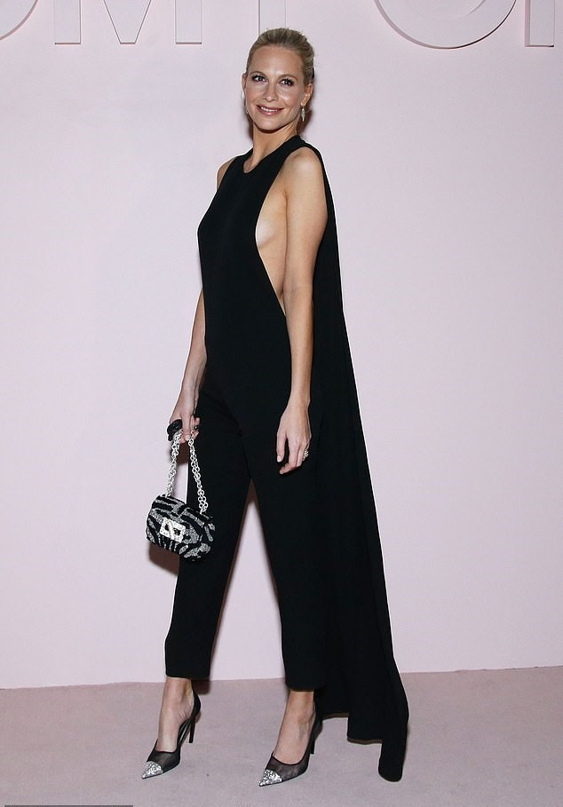 jumpsuit poppy delevingne model off-duty all black everything pants cape top celebrity