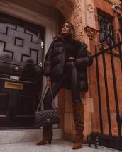 shoes,brown boots,knee high boots,ysl,chanel bag,black bag,black leggings,black jacket,puffer jacket,black turtleneck top
