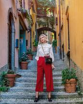 pants,red pants,cropped pants,blouse,top,white top,shoes,spring,spring outfits
