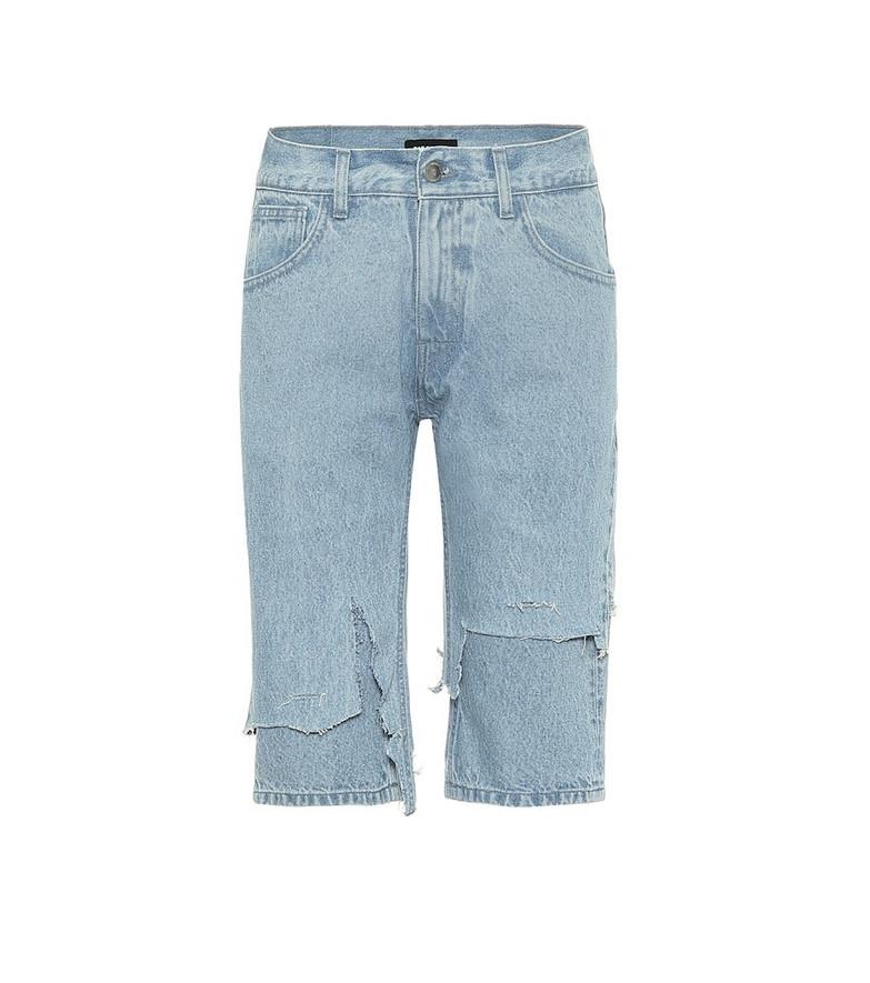 Raf Simons Distressed mid-rise denim shorts in blue