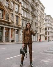jacket,blazer,snake print,straight pants,black boots,black bag,shoulder bag,classy