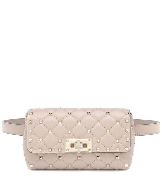 Valentino Garavani Rockstud Spike leather belt bag in pink