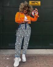 jacket,denim jacket,orange,high waisted pants,crossbody bag,white shoes,platform shoes,cropped jacket,white top