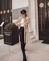 pants,black leather pants,black boots,trench coat,white top,cap