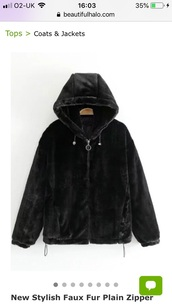 coat,a black fur coat with a drawstring on the bottlm