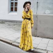 dress,maxi dress,floral dress,long sleeve dress,yellow dress,v neck,sneakers,black belt,hat