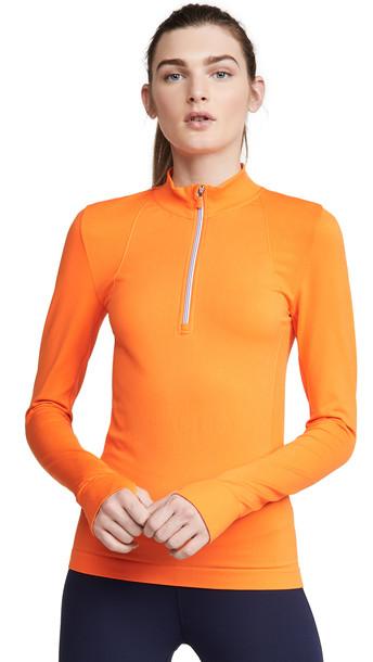 Tory Sport Seamless Quarter Zip Pullover in orange