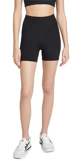 Girlfriend Collective High Rise Run Shorts in black