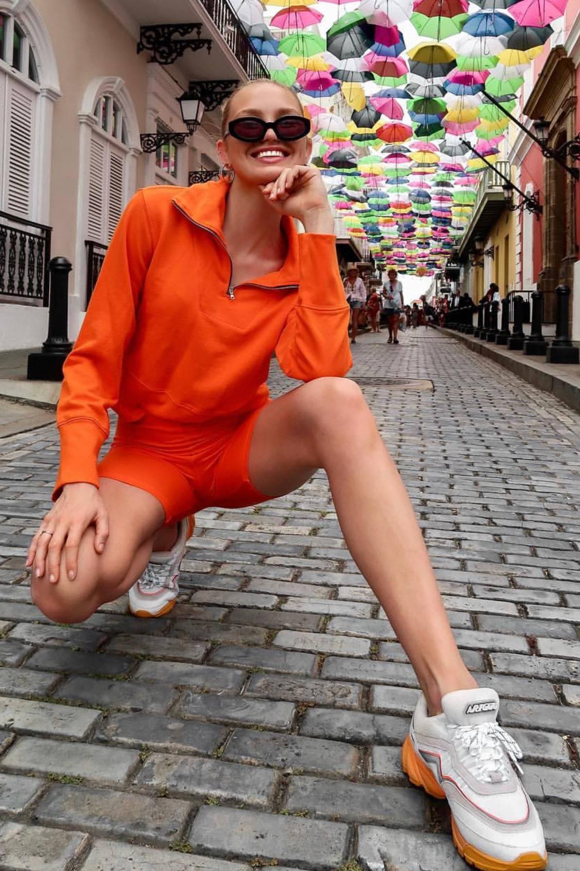 sweater orange shorts biker shorts romee strijd model off-duty instagram