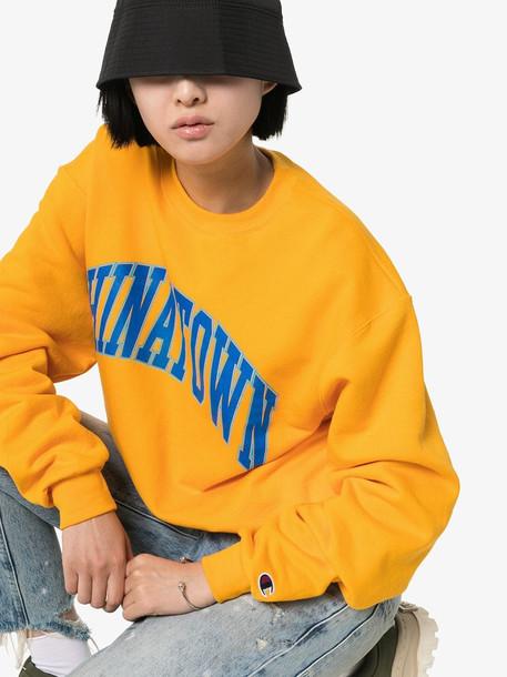 Chinatown Market x Browns logo printed sweatshirt in brown / yellow