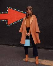 coat,brown boots,bucket bag,blue bag,high waisted pants,turtleneck sweater,beret