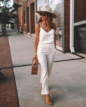 jumpsuit,sleeveless,sandal heels,hat,handbag