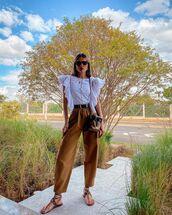 pants,high waisted pants,flat sandals,white blouse,crossbody bag
