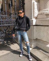 jeans,ripped jeans,black hoodie,sneakers,black bag
