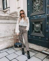 pants,high waisted,plaid,black boots,lace up boots,gucci bag,black bag,white sweater,knitted sweater