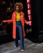 jeans,flare jeans,high waisted jeans,sneakers,orange coat,long coat,yellow sweater,shoulder bag,fendi