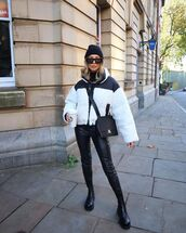 pants,black leather pants,black boots,puffer jacket,white jacket,black bag,beanie,turtleneck