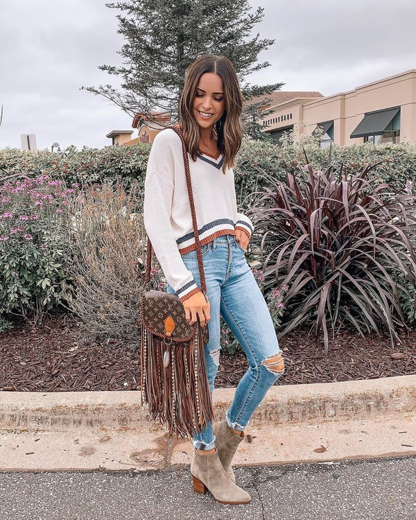 sweater white sweater skinny jeans ripped jeans ankle boots louis vuitton bag