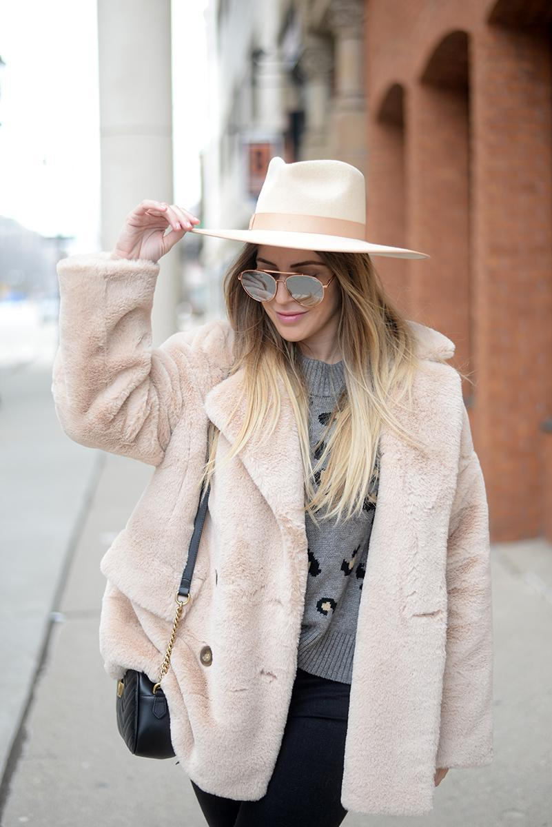 hat blonde bedhead blogger sweater coat jeans winter outfits faux fur jacket grey sweater