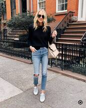 sweater,black sweater,ripped jeans,cropped jeans,white sneakers,maxi bag,black sunglasses,streetstyle
