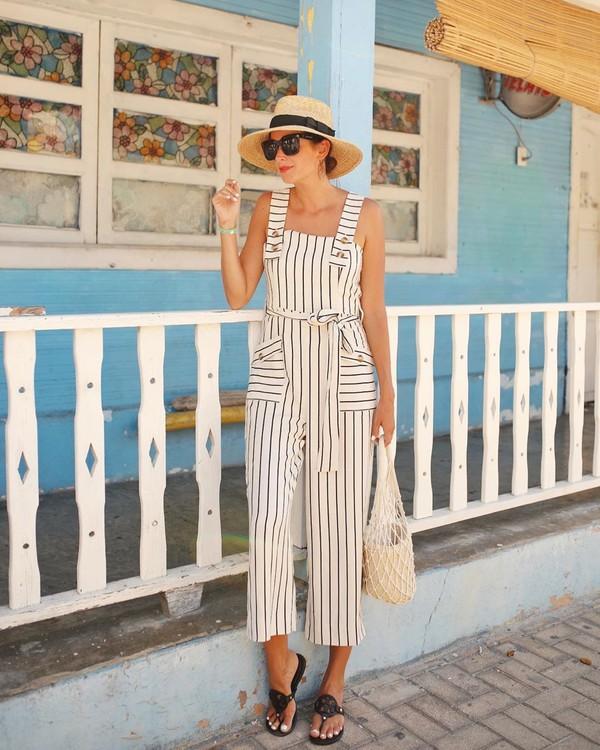 jumpsuit stripes sleeveless flat sandals bucket bag tote bag sun hat
