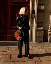 bag,brown bag,leather,black pants,black boots