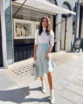 skirt,asymmetrical skirt,blue skirt,ankle boots,turtleneck sweater,white turtleneck top,white bag