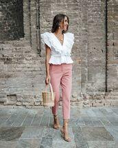 top,white blouse,ruffle,skinny pants,sandal heels,bucket bag