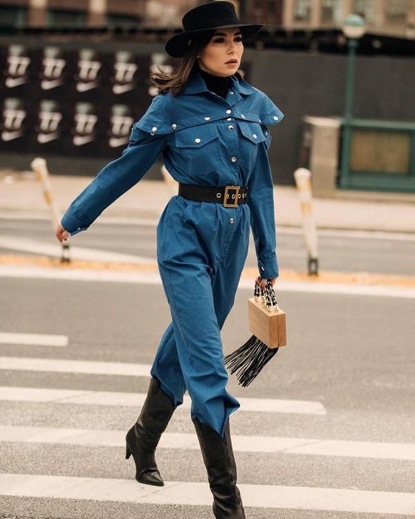shoes cowboy boots black boots heel boots blue jumpsuit long sleeves 90s style wood boxed bag handbag fringes black belt hat black turtleneck top