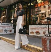 top,black t-shirt,mango,high waisted pants,flare pants,white pants,zara,white sandals,chanel bag