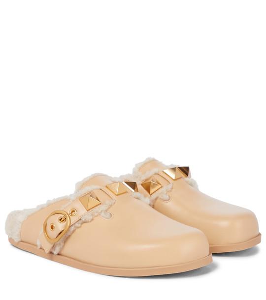 Valentino Garavani Roman Stud wool-lined leather slides in beige