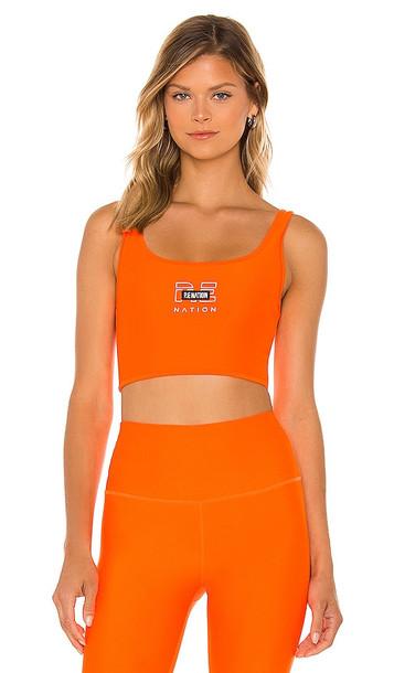 P.E Nation Grand Stand Sports Bra in Orange