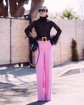 pants,high waisted pants,pleated,pink pants,black bag,black turtleneck top,belt