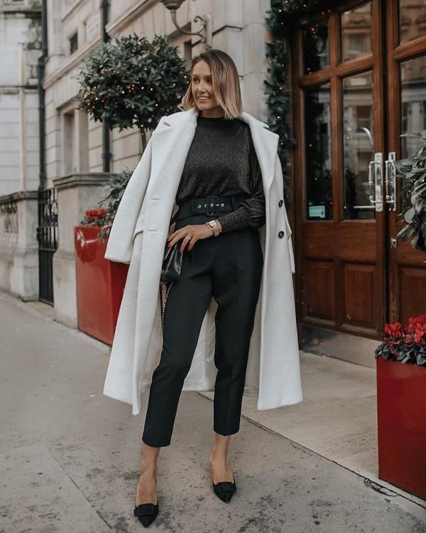 top black pants cropped pants mules white coat long coat black bag