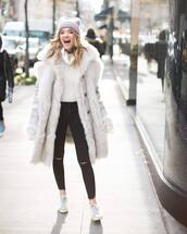 jeans,black skinny jeans,black ripped jeans,white sneakers,trainers,white coat,faux fur coat,white sweater,turtleneck sweater,knit,hat,beanie