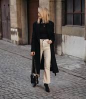 coat,black coat,black boots,acne studios,black bag,flare pants,white pants,black turtleneck top