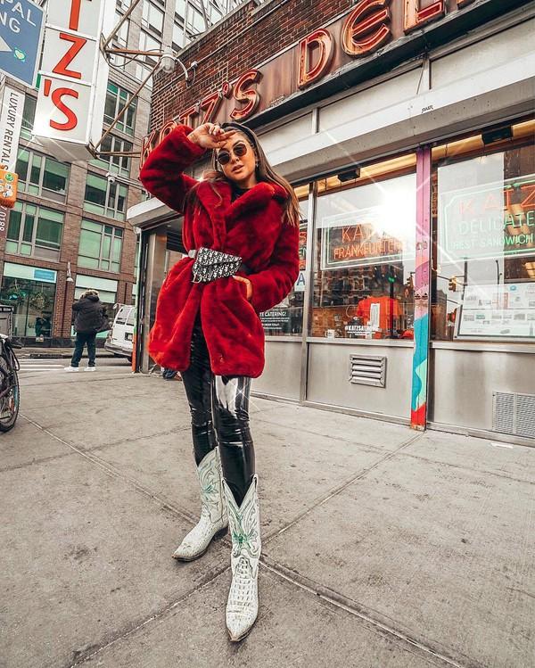 coat faux fur coat red coat cowboy boots black vinyl pants dior bag belt bag black top
