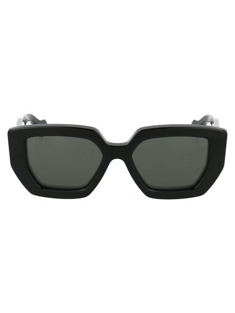 Gucci Sunglasses in black / grey
