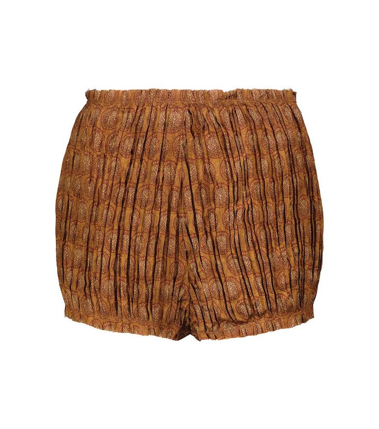 KHAITE Hilary high-rise shorts in orange
