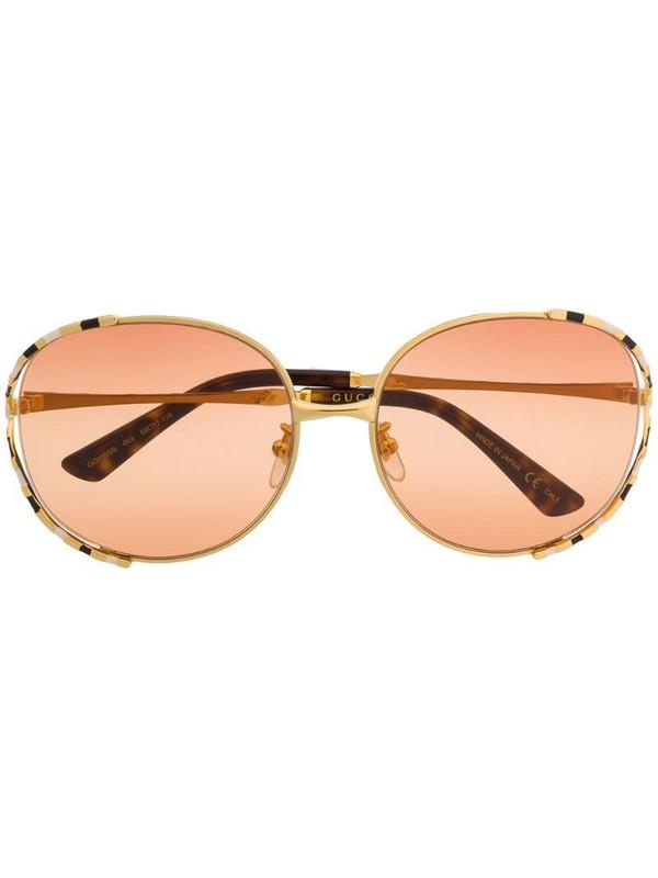 Gucci Eyewear striped frame sunglasses in gold
