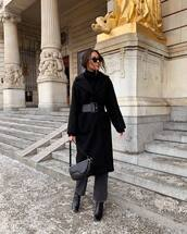 coat,black coat,long coat,black boots,grey jeans,straight jeans,black bag,black belt,black sweater,black turtleneck top