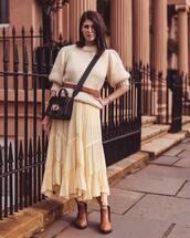 sweater,wool sweater,mohair,maxi skirt,asymmetrical skirt,ankle boots,brown boots,black bag,belt