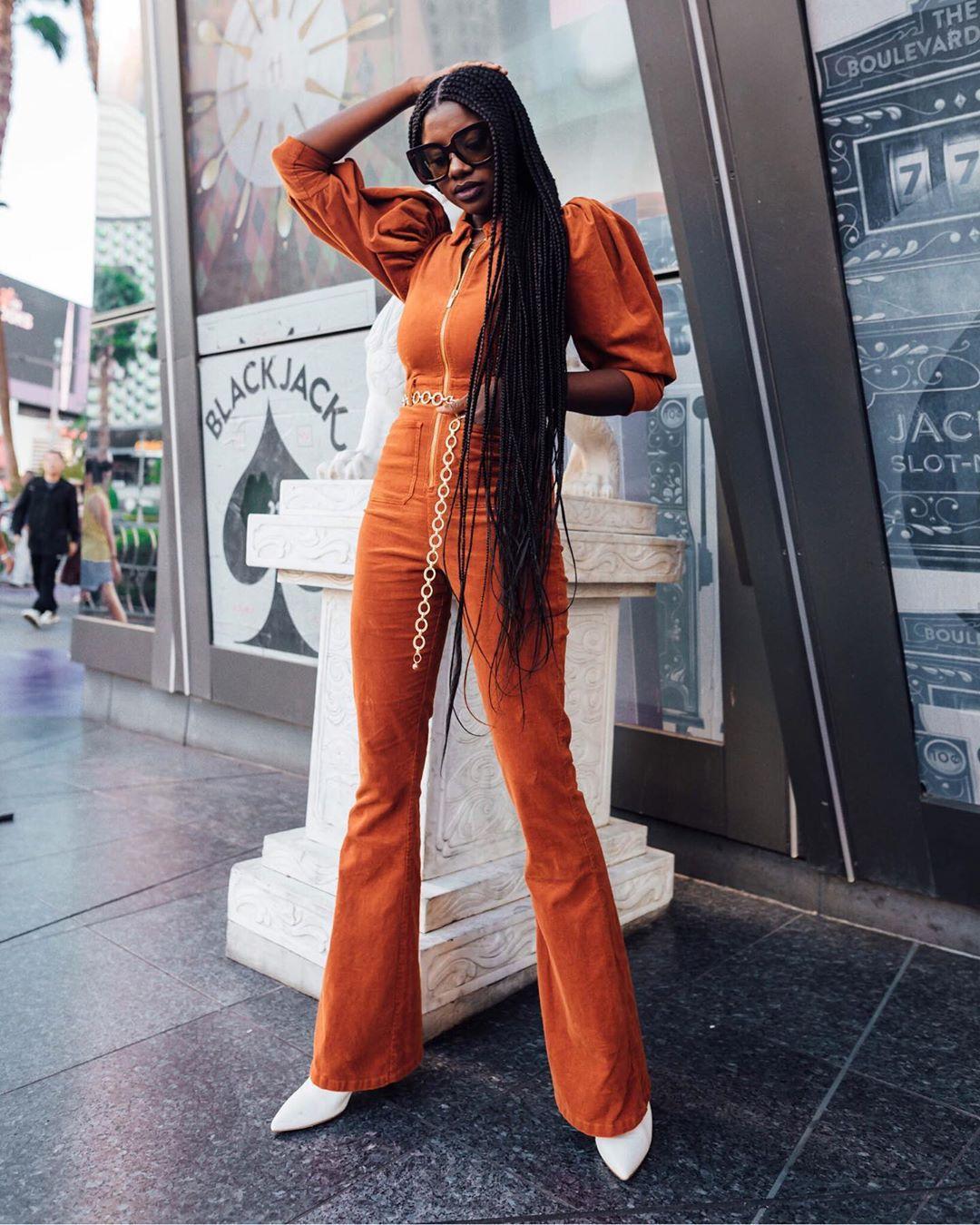 jumpsuit orange flare long sleeves white boots